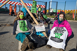 Anti-HS2 activists use an arm-tube lock-on and a tripod to block one of several entrances blocked to the Chiltern Tunnel South Portal site for the HS2 high-speed rail link on 9 October 2020 in West Hyde, United Kingdom. The protest action, at the site from which HS2 Ltd intends to drill a 10-mile tunnel through the Chilterns, was intended to remind Prime Minister Boris Johnson that he committed to remove deforestation from supply chains and to provide legal protection for 30% of UK land for biodiversity by 2030 at the first UN Summit on Biodiversity on 30th September.