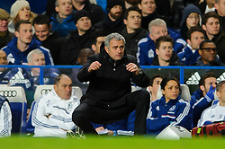 Jose Mourinho (POR), seeking his 100th Barclays Premier League win as Chelsea manager, crouches down nervously as Man Utd go close to scoring during the match - Photo mandatory by-line: Rogan Thomson/JMP - Tel: 07966 386802 - 19/01/2014 - SPORT - FOOTBALL - Stamford Bridge, London - Chelsea v Manchester United - Barclays Premier League.