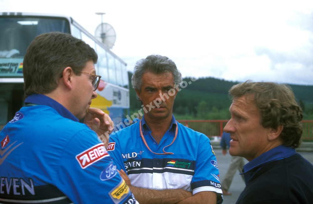 Benetton-Ford technical director Ross Brawn and team principals Flavio Briatore and Tom Walkinshaw in the paddock before the 1994 Belgian Grand Prix in Spa-Francorchamps. Photo: Grand Prix Photo