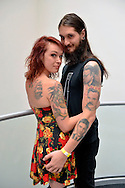 Garden City, New York, USA. September 14, 2014. PAT SULLY and CATERINA, of Massapequa, are at the United Ink Flight 914 tattoo convention at the Cradle of Aviation museum of Long Island. Later that night, Caterina was suspended from two ropes with hooks pierced through the skin of her back, at the outdoor body suspension show.