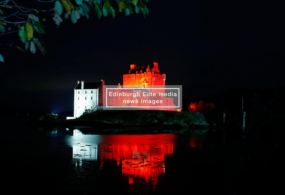 Eilean Donan Castle is one of the most recognised castles in Scotland. It is lit up red until 12 November in support of the Scottish Poppy Appeal.. .. (c) Stephen Lawson   Edinburgh Elite media