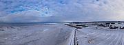 Nederland, Noord-Holland, Wieringen, 10-02-2021; Golfbrekers bij Stroe en zicht op de winterse Waddenzee, het wad is gedeeltelijk bevroren.<br /> Breakwaters at Stroe and a view of the wintry Wadden Sea, the mudflats are partially frozen.<br /> <br /> drone-opname (luchtopname, toeslag op standaard tarieven);<br /> drone recording (aerial, additional fee required);<br /> copyright foto/photo Siebe Swart
