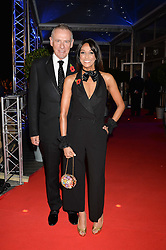 JACKIE ST.CLAIR and CARL MICHAELSON at Battersea Dogs & Cats Home's Collars & Coats Gala Ball held at Battersea Evolution, Battersea Park, London on30th October 2014.
