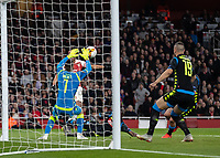 Football - 2018 / 2019 UEFA Europa League - Quarter Final, First Leg Arsenal vs. Napoli <br /> <br /> Alex Meret (Napoli) saves from Pierre-Emerick Aubameyang (Arsenal FC) at The Emirates.<br /> <br /> COLORSPORT/DANIEL BEARHAM