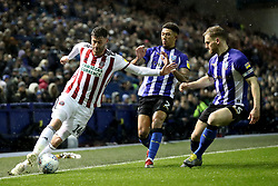 Sheffield United's Billy Sharp in action with Sheffield Wednesday's Liam Palmer and Tom Lees
