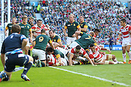 Japan's Captain Michael Leitch touches down for a try during the Rugby World Cup Pool B match between South Africa and Japan at the Community Stadium, Brighton and Hove, England on 19 September 2015. Photo by Phil Duncan.