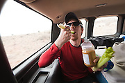 Francis Rengers, on a geology field trip with the University of Colorado, eats peanut butter and celery while riding in the back of a van in Southern Utah.