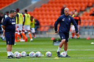Wimbledon Assistant Manager Neil Cox leads the warming up of the Wimbledon players during the EFL Sky Bet League 1 match between Blackpool and AFC Wimbledon at Bloomfield Road, Blackpool, England on 20 October 2018.