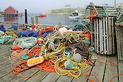 Fishing boats and gear in village<br /> Peggy's Cove <br /> Nova Scotia<br /> Canada