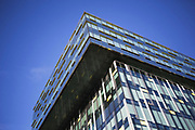 Modern building in Southwark, London. This piece of architecture imposes itself amongst one of London's oldest areas amid blue cloud sky.