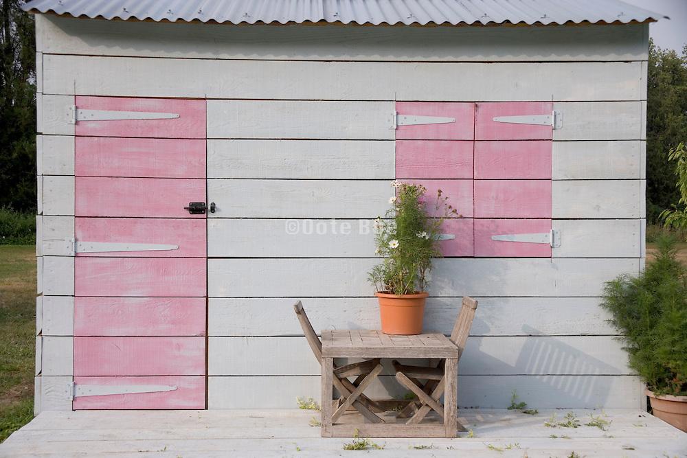 an idyllic little garden cabin