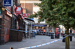 © Licensed to London News Pictures. 21/08/2018. LONDON, UK.  A police cordon is set up on Imperial Drive near Rayners Lane tube station, north west London, following a shooting in which two men suffered gunshot wounds.  It is reported that the suspect and accomplice have been.   Investigations are ongoing.  Photo credit: Stephen Chung/LNP