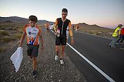 Sebastiaan Bowier loopt met trainer Niels naar de rustplek na zijn race op de derde racedag van het WHPSC. In de buurt van Battle Mountain, Nevada, strijden van 10 tot en met 15 september 2012 verschillende teams om het wereldrecord fietsen tijdens de World Human Powered Speed Challenge. Het huidige record is 133 km/h.<br /> <br /> Sebastiaan Bowier is walking back with trainer Niels after his ride on the third day of the wHPSC. Near Battle Mountain, Nevada, several teams are trying to set a new world record cycling at the World Human Powered Speed Challenge from Sept. 10th till Sept. 15th. The current record is 133 km/h.