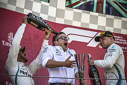 May 13, 2018 - Barcelona, Catalonia, Spain - LEWIS HAMILTON (GBR) celebrate on the podium spouring  champagne on the head of technical chief JAMES ALLISON at the end of the Spanish GP at Circuit de Barcelona - Catalunya (Credit Image: © Matthias Oesterle via ZUMA Wire)
