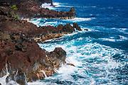 Rocky coastline and surf at MacKenzie State Park, Pahoa, The Big Island, Hawaii USA