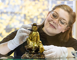 The Bonhams Asian Art Sale takes place on Thursday 15 November at 22 Queen Street Edinburgh starting at 11 am. It features Japanese and Chinese Art including: bronzes, jades, snuff bottles, porcelain, textiles, lacquer, paintings and furniture.<br /> <br /> Pictured: A gilt bronze group of Guanyan and Sudhana valued between £6,000 and £7,000 viewed by Jaine Heggie of Bonhams