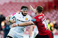 Don Armand of Exeter Chiefs under pressure from Ruan Ackermann of Gloucester Rugby during the Gallagher Premiership Rugby match between Gloucester Rugby and Exeter Chiefs at the Kingsholm Stadium, Gloucester, United Kingdom on 26 March 2021.