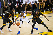 Golden State Warriors forward Kevin Durant (35) battles for a loose ball against Cleveland Cavaliers guard Kyrie Irving (2) and Cleveland Cavaliers center Tristan Thompson (13) during Game 2 of the NBA Finals at Oracle Arena in Oakland, Calif., on June 4, 2017. (Stan Olszewski/Special to S.F. Examiner)
