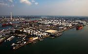 Nederland, Zuid-Holland, Rotterdam 19-09-2009; zicht op 3e Petroleumhaven, Geulhaven met binnenvaartschepen, olieterminal met oplagtanks, containers. Op het tweede plan Olieraffinaderij (Shell), Botlek en Botlekbrug. .View of 3rd Petroleumhaven 3rd, Geul Harbor with barges (l), oil terminal with oil tanks, containers. Backgroumd  oil refinery (Shell).luchtfoto (toeslag), aerial photo (additional fee required).foto/photo Siebe Swart