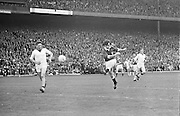 Galway kicks the ball flying towards the goal during the All Ireland Senior Gaelic Football Championship Final Cork v Galway in Croke Park on the 23rd September 1973. Cork 3-17 Galway 2-13.