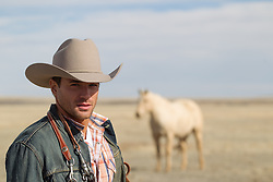 rugged cowboy on a horse ranch