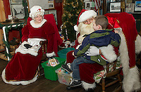 Mr. and Mrs. Claus at the Lakeport Freight House Museum Saturday afternoon.  (Karen Bobotas/for the Laconia Daily Sun)