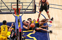 Jan 25, 2021; Morgantown, West Virginia, USA; Texas Tech Red Raiders guard Kevin McCullar (15) dives for a loose ball during the second half against the West Virginia Mountaineers at WVU Coliseum. Mandatory Credit: Ben Queen-USA TODAY Sports