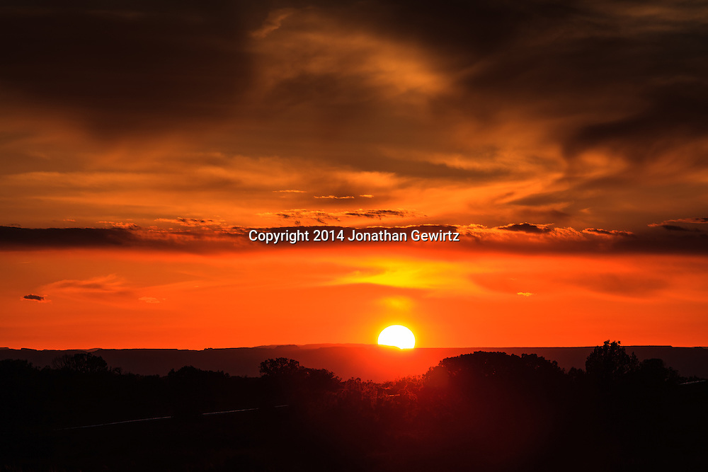 A colorful sunset as seen from the high desert plateau northwest of Moab Utah.<br /> WATERMARKS WILL NOT APPEAR ON PRINTS OR LICENSED IMAGES.