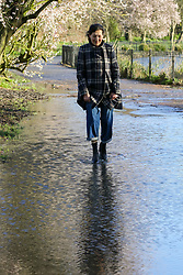 © Licensed to London News Pictures. 17/02/2020. London, UK. A woman walks through the flood in Clissold Park, north London, caused by heavy rain from Storm Dennis. Photo credit: Dinendra Haria/LNP