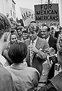 """Stockton, California, March 1967.--RFK came to Stagg High School to attend a senate committee hearing on the conditions of poor people.    Robert Francis """"Bobby"""" Kennedy (November 20, 1925 - June 6, 1968), also called RFK, was the United States Attorney General from 1961 to 1964 and a US Senator from New York from 1965 until his assassination in 1968. He was one of US President John F. Kennedy's younger brothers, and also one of his most trusted advisors and worked closely with the president during the Cuban Missile Crisis. He also made a significant contribution to the African-American Civil Rights Movement..Photo by Al GOLUB/Golub Photography."""