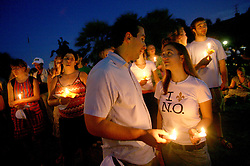 29 August 2007. New Orleans, Louisiana. <br /> Candlelit vigil, St Louis Cathedral, Jackson Square. Mourners gather to pay their respects to the many victims of Hurricane Katrina on the evening of the second anniversary. <br /> Photo credit; Charlie Varley.