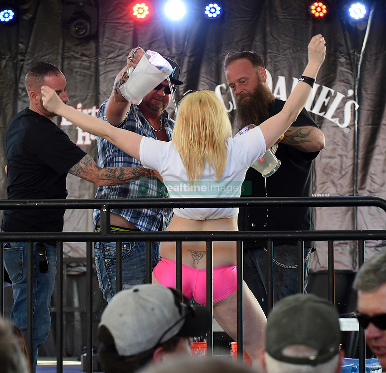 March 8, 2019 - Daytona, FL, United States - Men pour ice water on a contestant in a wet t-shirt contest on March 8, 2019, the opening day of Bike Week in Daytona Beach, Florida. The 10-day event, which draws thousands of motorcycle riders and enthusiasts from around the world, is celebrating its 78th year. (Credit Image: © Paul Hennessy/NurPhoto via ZUMA Press)