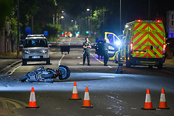 © Licensed to London News Pictures. 06/09/2021. High Wycombe, UK. A motorbike lays on the ground at the scene in High Wycombe following a fatal road traffic collision involving a car and a motorbike. Emergency services, including an air ambulance, were called to the scene at approximately 20:15BST to the corner of London Road (A40) and Hammersley Lane. The motorcyclist died at the scene. A large section of London Road between Station Road and Gomm Road was closed for several hours as police conducted an investigation into the collision. Photo credit: Peter Manning/LNP