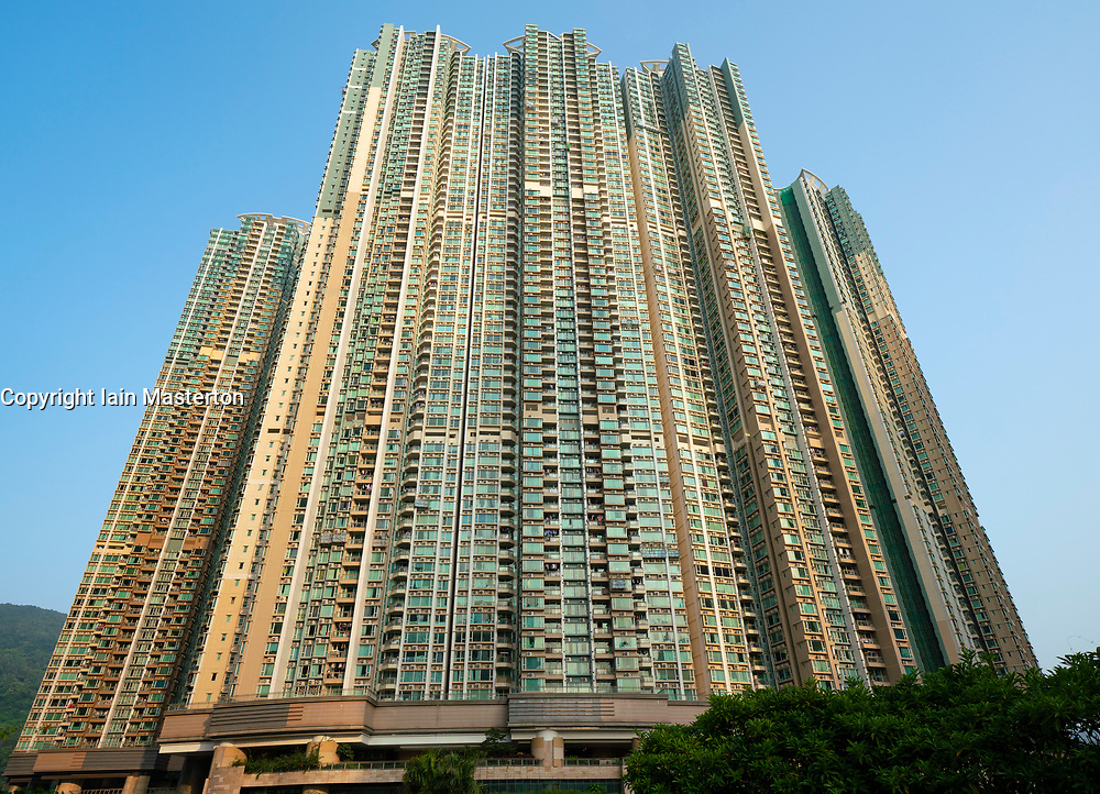 Facade of dense urban high-rise apartment buildings in LOHAS Park new housing estate in New Territories of Hong Kong, China.