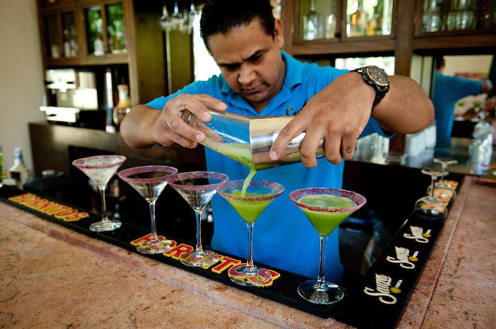 """A bartender at the Casa Sauza distillery in Tequila pours """"tequinis"""" for visitors."""