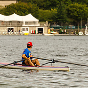 What is the oarsman thinking as he looks across the Charles towards Cambridge?  It was a perfect autumn morning in Boston, ideal for a turn at the oars.