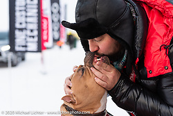 Showing the love, Aleksey Mishenin with his dog at the Baikal Mile Ice Speed Festival. Maksimiha, Siberia, Russia. Saturday, February 29, 2020. Photography ©2020 Michael Lichter.