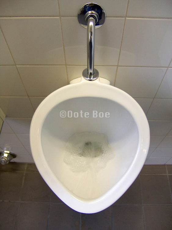 urinal while water is flushing