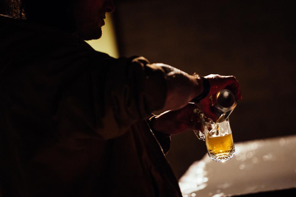 Joseph Paine sending beers down the Gelande Quaff practice table a the Hostel.