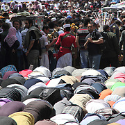 Thousands join in communal worship before joining in solidarity to further their revolution in Cairo's Tahrir Square.