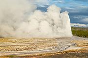 Old Faithful geyser erupting in Yellowstone National Park