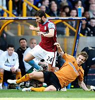 Photo: Steve Bond/Richard Lane Photography. Wolverhampton Wanderers v Aston Villa. Barclays Premiership 2009/10. 24/10/2009. Carlos Cuellar (L) is tackled by Kevin Doyle