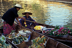 Asia, Thailand, 104 km southwest of Bangkok. Damnoen Saduak Floating Market. Flower and fruit vendors meet on canal