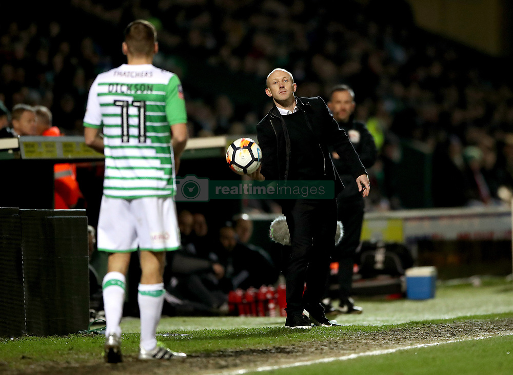 """Yeovil Town manager Darren Way throws the ball to Ryan Dickson (11) during the Emirates FA Cup, fourth round match at Huish Park, Yeovil. PRESS ASSOCIATION Photo. Picture date: Friday January 26, 2018. See PA story SOCCER Yeovil. Photo credit should read: Nick Potts/PA Wire. RESTRICTIONS: EDITORIAL USE ONLY No use with unauthorised audio, video, data, fixture lists, club/league logos or """"live"""" services. Online in-match use limited to 75 images, no video emulation. No use in betting, games or single club/league/player publications."""