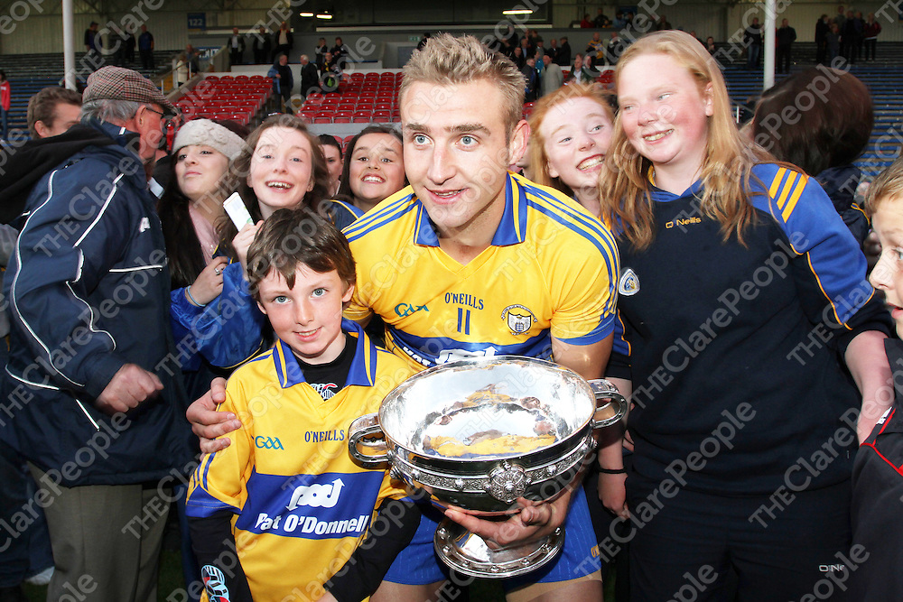 Ian McNamara supporter & Clare Captain Tony Carmody with the Cup after defeating Kilkenny in the All Ireland Intermediate Final at Thurles. - Photograph by Flann Howard