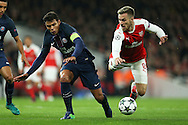Thiago Silva of Paris Saint-Germain and Aaron Ramsey of Arsenal ® collide as they challenge for the ball.  UEFA Champions league group A match, Arsenal v Paris Saint Germain at the Emirates Stadium in London on Wednesday 23rd November 2016.<br /> pic by John Patrick Fletcher, Andrew Orchard sports photography.
