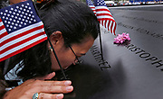 Lucy Vale kisses the engraved name of her husband Ivan Vale on the wall of the North Pool during ceremonies marking the 10th anniversary of the 9/11 attacks on the World Trade Center in New York, September 11, 2011.