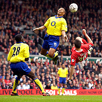 Photo. Jed Wee.<br /> Liverpool v Arsenal, FA Barclaycard Premiership, Anfield, Liverpool. 04/10/03.<br /> Liverpool's Anthony Le Tallec (R) tries an acrobatic shot at goal as Arsenal's Gilberto Silva (C) gets in the way.