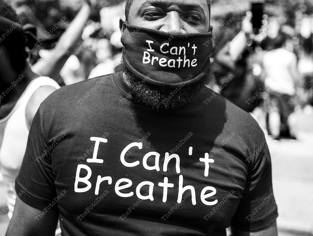 """PLAINFIELD, NEW JERSEY: Basheer Smith, 30 of Plainfield, New Jersey wears a a mask and T shirt that says """"I can't Breathe."""" Smith was out protesting on the steps of Plainfield City Hall because """"of all the social injustices that is going on in the Black community."""" during a Justice for George Floyd protest and rally in Plainfield, New Jersey on Saturday June 6, 2020. Tens of thousands of people protested across the United States and in cities around the world for a tenth day of outrage over police brutality intensified over the death ofGeorge Floyd. (Brian Branch-Price/TheFotoDesk)."""