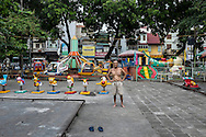A man exercises in a deserted playground in Hanoi, Vietnam, Southeast Asia